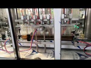 makinë automatike për mbushjen e vajit të motorit